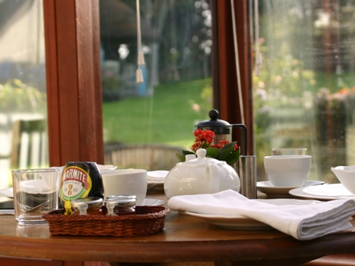 Enjoy breakfast with views into the garden